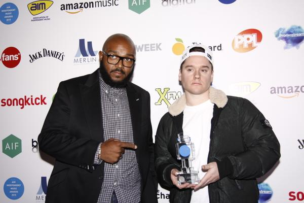 BRITHOPTV: [News] DJ Logan Sama (@djlogansama) accepts 'Oustanding Contribution To Music' Award on behalf of Skepta (@Skepta) At AIM Independent Music Awards 2015 | #Music #MusicNews